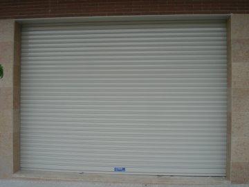 Tipos de persianas y puertas enrollables for Puerta garaje metalica